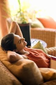A woman enjoying the comfortable temperature indoors.