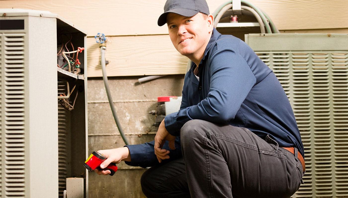 HVAC Technician doing maintenance.