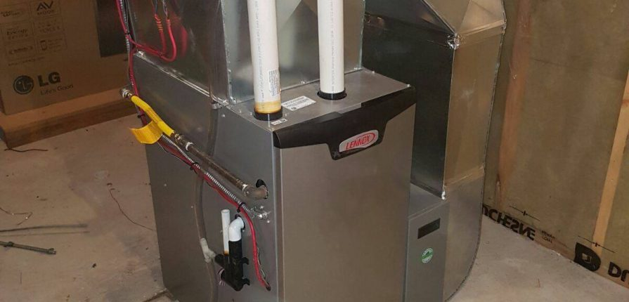 A brand new lennox furnace installed in a basement.