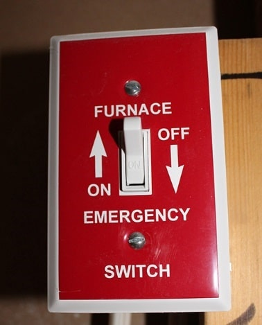 Red switch that can turn off power to a furnace.