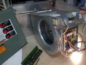 A brand new furnace fan blower and motor.